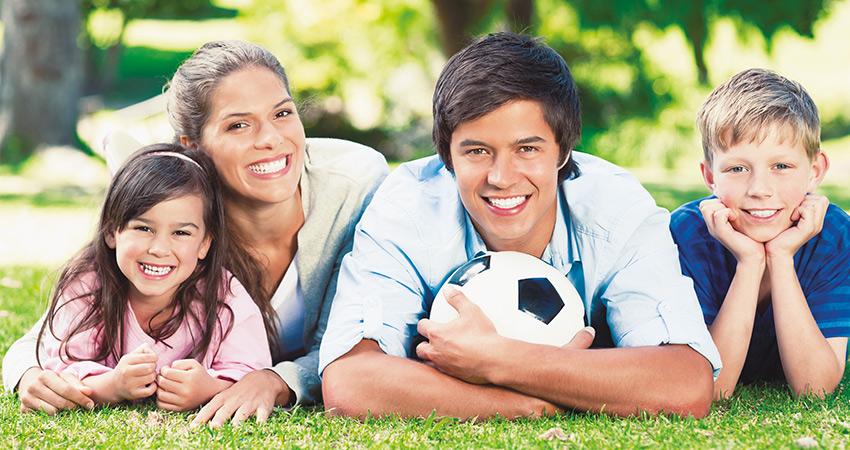 caucasian family looking at camera smiling